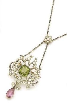 A seed pearl, peridot and tourmaline pendant necklace, circa 1890 The scrolling openwork plaque centrally-set with a collet-set square-cut peridot in a surround of half seed pearls, suspending a pear-shaped pink tourmaline drop. by BunnyBeer