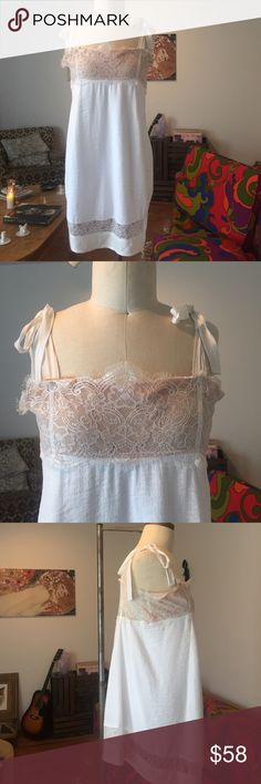 For Love and Lemons Cream Bo Peep Dress Size L! Elegantly sexy 'Bo Peep' white lace shift by collectible boho chic L.A. line For Love and Lemons! Knee length rayon / linen blend dress is fully lined and not see through. Totally dreamy and easy to wear. Great condition- a light yellow mark on one of the ribbon straps, not noticeable when tied. For Love and Lemons Dresses