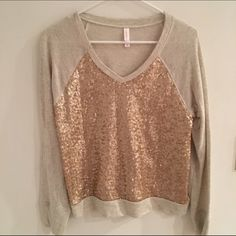 V-neck sweatshirt Oatmeal with gold/champagne sequins. New without tags.  *Please note that if a item is priced $10 or under it is FIRM. There is a flat fee PM takes for all sales under $15 and that fee is $2.95. I would much rather donate an item than take less. Thank you kindly* Xhilaration Sweaters