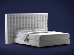 Upholstered double bed with high headboard Sanya Series by Flou | design Carlo Colombo