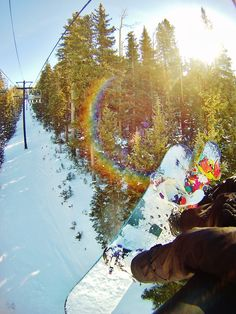 Snowboard chairlift with a sun flare - morning in the mountains