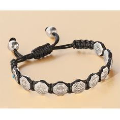 I've long wanted an Eight Auspicious Symbols Protection Bracelet, and this one's on sale at DharmaCrafts, but I dunno...