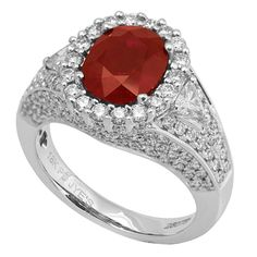 RR25075H: This ring will surely turn heads with its 3.04ct ruby center stone and diamond encrusted band. Made in 18K white gold, it features 1.5ct round diamonds and 0.23ct trillion cut diamonds. | www.goldcasters.com