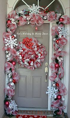 deco mesh garland and wreath in red and white peppermint stripes.