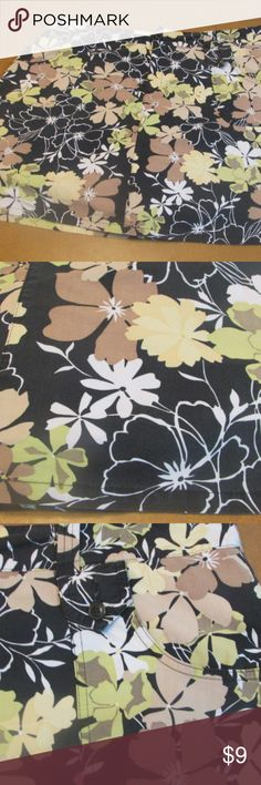 Black Floral Skirt with Shorts underneath This is a black, floral skirt with shorts under it. It is size 18 and is about 19 inches long. Any questions, please ask! White Stag Skirts