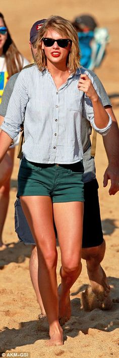 Fanfare: The singer later covered up in green shorts and a cute striped shirt for a stroll along the sandy beach