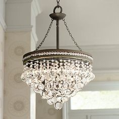 The Regina chandelier sparkles with refined style and clear crystal baubles.