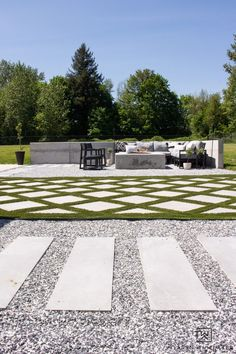 Backyard landscape design with concrete fire pit and modern outdoor space complete with grid style turf. Luxury Landscaping, Backyard Landscaping, Paver Walkway, Concrete Fire Pits, Cool Diy Projects, Curb Appeal, Stepping Stones, Landscape Design, Beautiful Homes