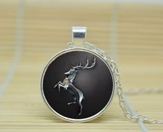 A silver stag set in onyx, for House Baratheon