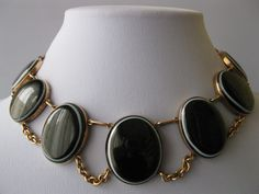 An antique bold bulls-eye agate and gold necklace from the Victorian era.