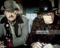 Actors William Holden as Ross Bodine and Ryan O'Neal as Frank Post in the western 'Wild Rovers' 1971