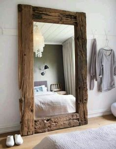 Drift wood used to frame an oversized floor mirror
