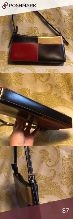 "Clutch or small shoulder bag Brick red, black, tan and chocolate patchwork purse. Light light used is excellent condition. Bought from a street vendor in New York for $30 so it's not real leather. A few minor scratch marks that aren't noticeable unless you look for them. Strap is adjustable or removable. 11"" wide 5"" high 1"" deep, 8"" strap drop Bags Clutches & Wristlets"