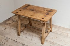 Bie Baert. small wooden table.