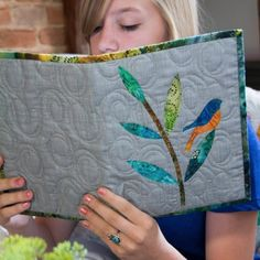 Beautiful GIFT IDEAS by Edyta Sitar @laundrybasketquilts using @accuquilt GO! Dies! This book cover is quick and easy. One of many patterns available! Visit the AccuQuilt website for more ideas!