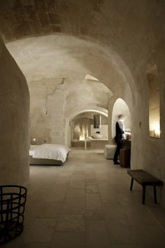 Room in the Hotel Corte San Pietro, located in Matera, one of the oldest and most unusual cities in Italy. This hotel is in a cave complex in Italy dating back to the century. Designed by architect Daniel Amoroso. Photo by PierMario Ruggeri. Interior Architecture, Interior And Exterior, Interior Design, Kitchen Interior, Modern Interior, Modern Decor, Cave City, Hotels And Resorts, Boutiques