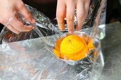 For the final step, wrap your one-of-a-kind Stuffed Orange with Crab Meat in a plastic wrap before serving!  #hangzhou #china #chinese  #foodie #dishes #recipe #specialty #cuisine #food #orange #crab #roe #savory #delights