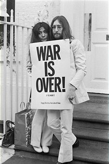 John Lennon (1940 - 1980) and Yoko Ono pose on the steps of the Apple building in London, holding one of the posters that they distributed to the world's major cities as part of a peace campaign protesting against the Vietnam War, December 1969. The poster reads 'War Is Over, If You Want It'.