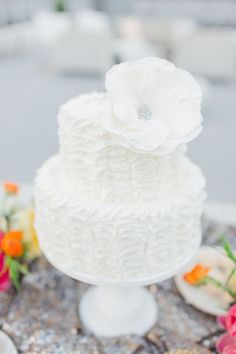 photo: Allen Tsai via Style Me Pretty; simple chic all white wedding cake; click to see more gorgeous white color wedding ideas