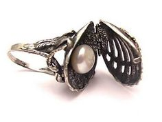 Oyster ring opens to reveal pearl.  And it's actually quite beautiful on top!