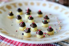 Mini Mini Mini cupcakes :)... Cute but it's the Corning ware plate that brings back the memories of home...