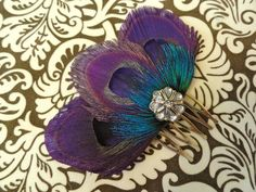 Purple peacock feather hair comb.