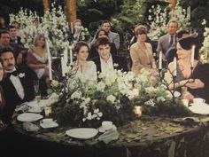 Note all the moss and ferns in the centre, with candelabras. We could do something on a similar theme with the candelabra in the middle, stood on wooden log, moss and ferns planted around. Could look amazing!