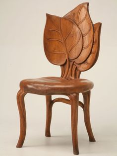 "Unusual hand-carved antique French Art Nouveau sculptural chair from the Mountain Region of France in excellent original condition. The wood species cannot be identified but is probably fruitwood. Seat height is 17"".  France circa 1900"