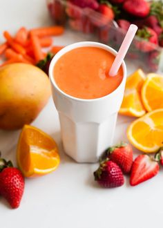Glowing Skin Coconut Water Smoothie with Mango and Strawberry -- who doesn't want radiant skin! All those luscious fruits and veggies really will give you a glow. Try it!
