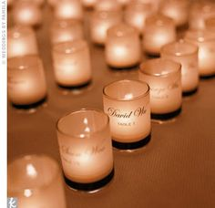 Votive candles that doubled as escort cards
