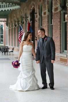 Bride and Groom - Elegant Plum and Orange Wedding at the Sheraton Riverwalk in Tampa, FL - Photo by Heather Rice Photography - click pin for more - www.orangeblossombride.com
