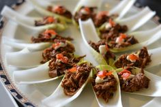 In this moreish canapé recipe, Danny Kingston cooks brisket low and slow over eight hours for sweet, tender, melt-in-the-mouth meat. Danny serves the shredded brisket on chicory leaves with a dollop of fiery horseradish and fukujinzuke – a delicious Japanese pickle made from cucumber, aubergine and daikon.