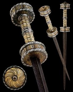 "A French Rondel Dagger, Burgundy circa 1450 The grip twisted with silver and gilt. The rondels inscribed with ME+FIE+AN+TOI / ESPOIR+EN+DIEU (""in you I trust--in God I believe"") Overall length: 49 cm (19.29""); Blade length: 33.1 cm (13"") Located at Reichsstadtmuseum Rothenburg, Germany"