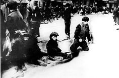 Children begging in a Warsaw ghetto street. The picture is the courtesy of Yad Vashem.