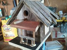 Bird house made from the mother load of old barn wood we found
