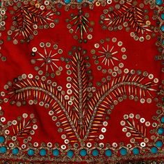 Poland - Plant motifs. Embroidered with sequins and the so-called owies oblong beads on the black of a woman's bodice