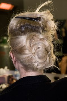 HOW TO!    Piled up and pinned.  An effortless updo.