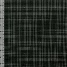 """A top quality charcoal and black plaid cotton spandex knit. Fabric is mid weight with a nice stretch and a smooth hand. Square measures 1/2""""..."""