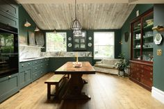 Green shaker Peckham Rye kitchen with marble splashback by deVOL Kitchens
