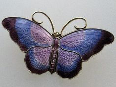 David Andersen enamelled butterfly brooch.  Photograph by Gillian Horsup. One of my Aunts tried to give me a handful of these and a platinum pin she thought were all cheap old pieces from the dime store.  I had her get the platinum and diamonds appraised.  They are in a bank now and the pins are on display.