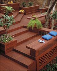 Sweet tiered deck with benches, cool angles, and plants.