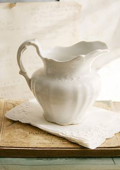 Water pitcher and linens.