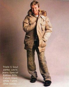 David Bowie wearing Levis, Calvin Kline white t shirt, and Dior Boots..