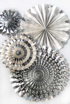 Elegant Silver Foil and Cream Fans to decorate your Candy Bar for a wedding, anniversary or shower. You get four fans to adorn your wedding or event! Perfect for any party or festive occasion! Sophisticated, modern and chic these dazzling party fans are a hit at any party or in any photo booth. Each unfolds into a full circle and includes an adhesive strip to hold them open, as well as a string for hanging. Adhesive circles for mounting are also included.