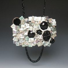 Tamara Grüner. Necklace: Jais Scarabee, 2012. Historical pressing in blackened metal, glass, mother of pearl, silver, onyx.