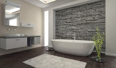 bathroom with stone wall and floor tile that looks like wood