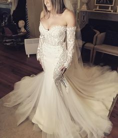 Leah Da Gloria off the shoulder wedding dress - Mermaid gowns have a timeless trendiness, and we are showcasing an even more niche trend