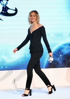 Jennifer Lawrence in an Antonio Berardi off-the-shoulder blazer in Beijing.