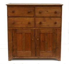 "DRAWERS OVER CUPBOARD Walnut and pine, natural finish, simple applied molded top over four dovetailed drawers, original turned walnut threaded pulls, two-by-two thumbnail molded edges, over two double vertical panel doors through mortised and pinned, on a slight arched and squared foot, original key for cupboard doors, Union Village, OH, c. 1850, (deaccessioned from a Massachusetts museum), 57"" h, 53"" w, 18 1/2"" d."