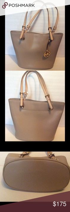 "Michael Kors Jet Set Tote Natural Gold-Tone NWT Michael Kors Jet Set Tote. Natural/Gold-Tone. Exterior slip pocket, 1 inside zipper pocket, 4 inside slip pocket. Adjustable handle straps, snap closure. 11'5"" x 10.5"" x 6.5"". NWT Michael Kors Bags Totes"